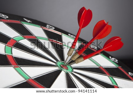dart hitting a target - stock photo