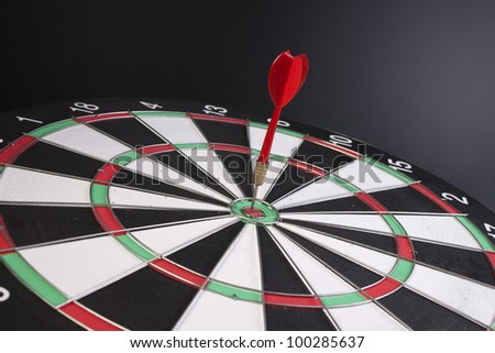 Dart in a target - stock photo