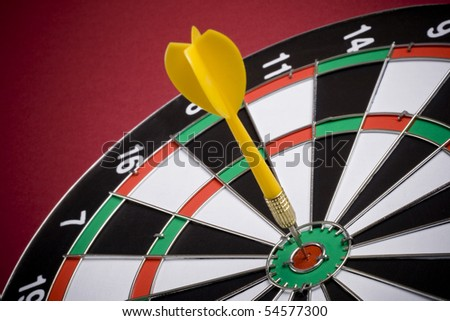 dart in center of target - stock photo