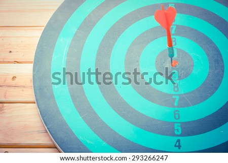 Dart is an opportunity and Dartboard is the target and goal. So both of that represent a challenge - Business concept  Bullseye and Dart. - stock photo