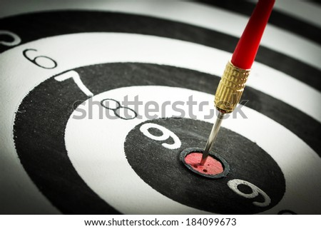 Dart pinned on the center of rings group - stock photo