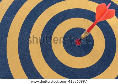 Dart target with arrow on bullseye in dartboard, Success marketing target business concept, abstract background - stock photo