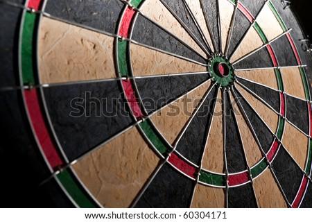 Dartboard wide angle dramatic light - stock photo