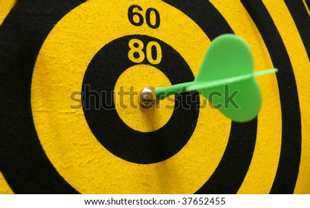 Dartboard with magnetic arrow - stock photo