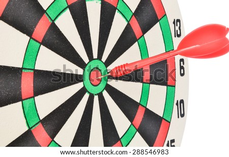 Dartboard with red dart at the center isolated on white background - stock photo