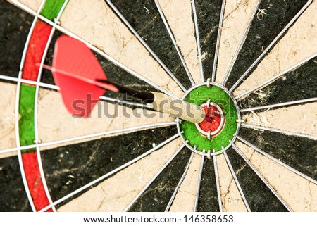 darts arrows in the target center bulls eye - stock photo