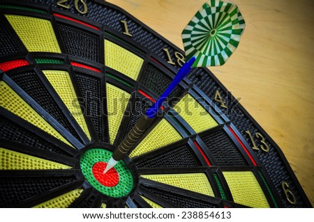 darts arrows in the target center, Darts game , arrows and darts target the exact game - stock photo