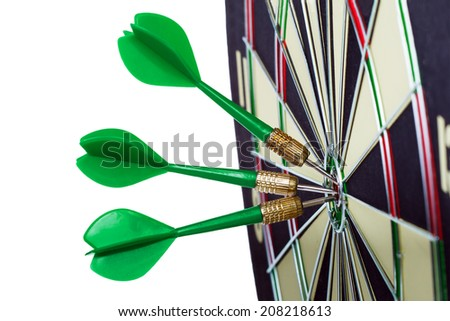 Darts arrows in the target center isolated on a white background. - stock photo