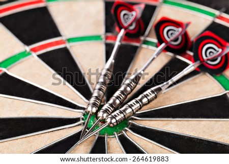darts arrows on the target - stock photo