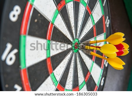 Darts hit the target all the media about the success of the team - stock photo