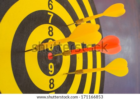 Darts hit the target to win - stock photo