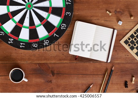 darts on wooden background. Business concept. Success hitting target aim goal achievement concept background. Top view on gameplace - stock photo