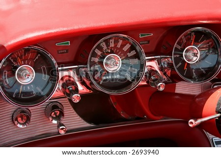 dashboard from the inside of a classic car - stock photo