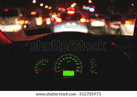 dashboard image of inside car with bokeh on evening time for background - stock photo