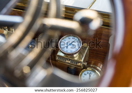 dashboard with analog clocks, very old car - stock photo