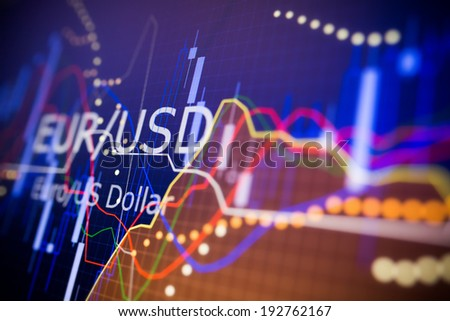 Data analyzing in foreign finance market: the charts and quotes on display. Analytics in pairs EUR / USD - stock photo