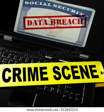 Data Breach text on Social Security card with crime scene tape on laptop computer - stock photo