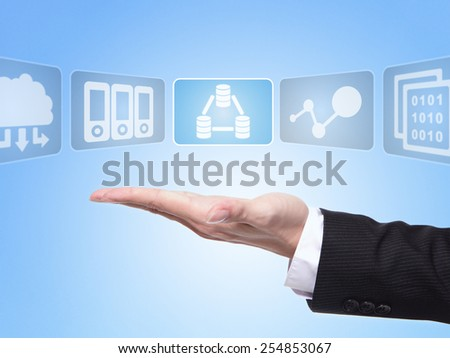 data science concept , business man hand palm holding all kinds of icon about data science with blue background - stock photo