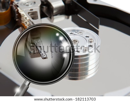 data search concept with opened hard drive disk and black magnifying glass  - stock photo