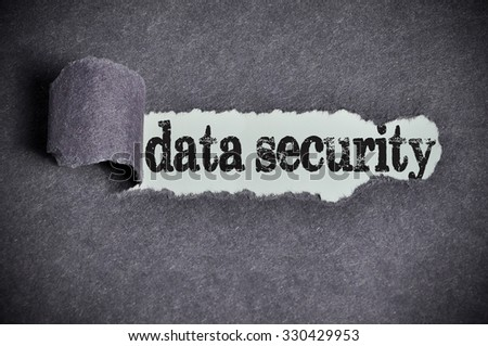 data security word under torn black sugar paper. - stock photo