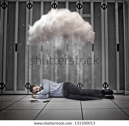 Data worker napping under cloud computing in data centre - stock photo