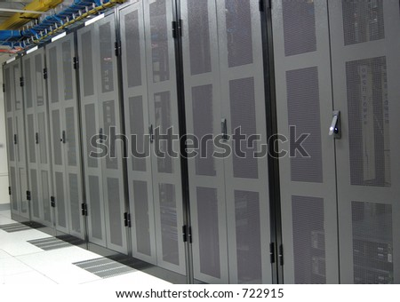 datacenter - clean row of server racks - stock photo