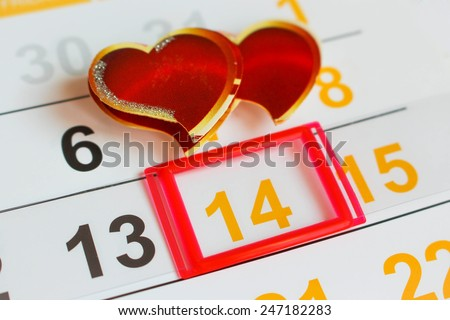 Date February 14 marked on the calendar. Two hearts the concept of love. - stock photo