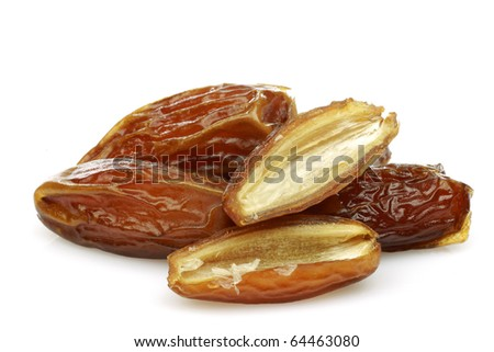date fruit and a cut one on a white background - stock photo