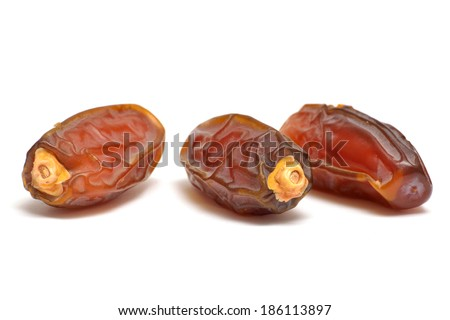 Date fruits close up isolated on white under studio lighting - stock photo