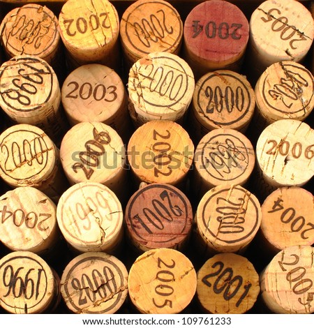 Dated Wine Bottle Corks with Staggered Heights. - stock photo