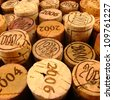 Dated Wine Bottle Corks with Staggered Heights. View 4. - stock photo