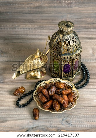 Dates, arabian lantern and rosary. Islamic holidays concept. Ramadan decoration - stock photo