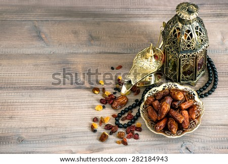 Dates, arabic lamps and rosary. Islamic holidays decoration concept - stock photo