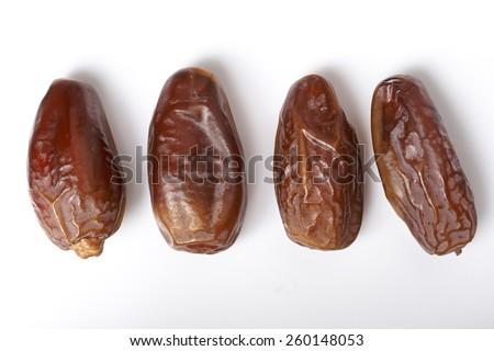 dates fruit isolated on white background - stock photo