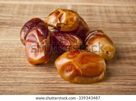 dates on a wooden background - stock photo
