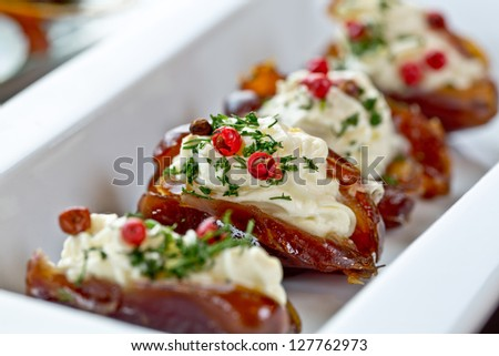 dates with cheese and lemon paste - stock photo