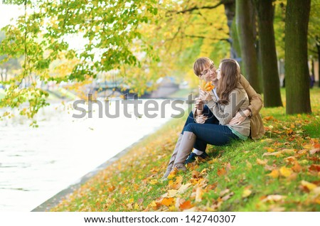 Dating couple on the river bank - stock photo