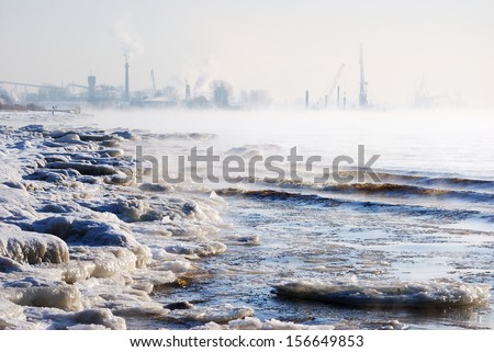 Daugava river in a cold winter day. Hoar frost and mist - stock photo