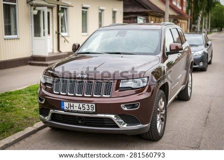 DAUGAVPILS, LATVIA - MAY 2015: Jeep Grand Cherokee parked on the street in Daugavpils town, Latvia - stock photo