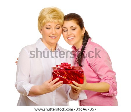 Daughter giving gift to her mother isolated - stock photo