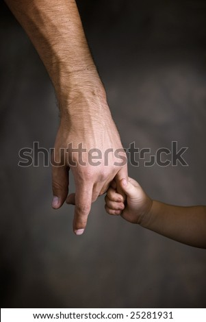Daughter holds the hand of the father - stock photo