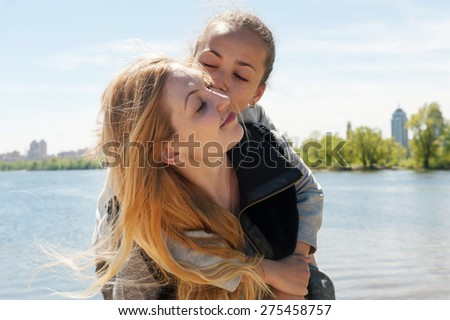 Daughter kissing mother - stock photo