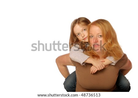 Daughter on moms back - stock photo