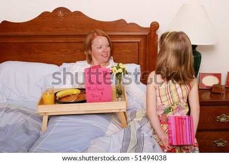Daughter surprising mom on Mothers day - stock photo