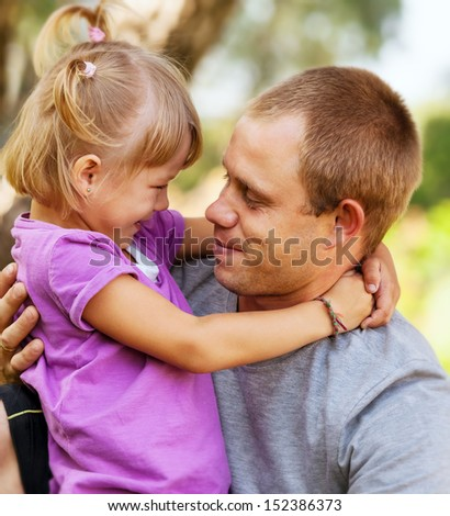 Daughter tender hugs her father - stock photo