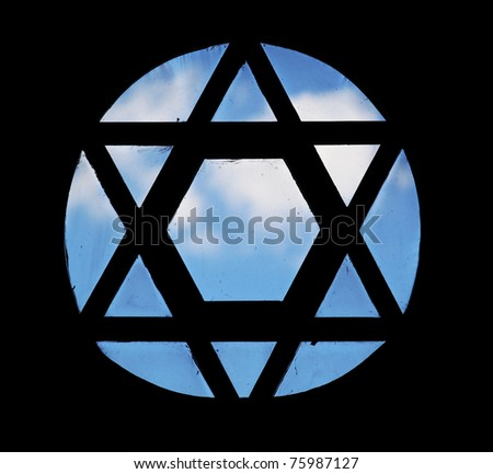 David's star shape window in a synagogue - stock photo