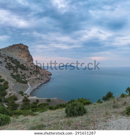 Dawn at Black sea. Morning seascape with mountains. - stock photo