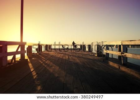 Dawn at the fishing jetty at Woodbridge, Tasmania, Australia  - stock photo