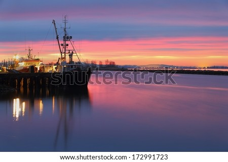 Dawn at the marina in Steveston Harbor, British Columbia, Canada where the commercial fishing fleet prepares to leave the dock. Located at the mouth of the Fraser River near Vancouver.  - stock photo