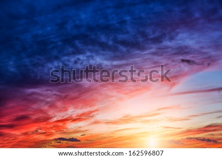 dawn clouds in the sky in the sunset - stock photo